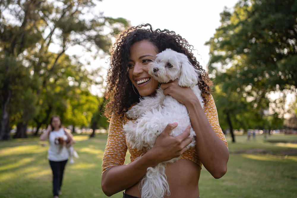 Woman with her cute dog.